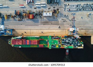 Aerial view of a roll on roll off container ship loaded with cars and shipping containers