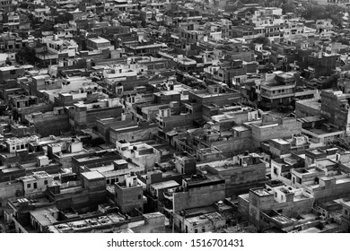 aerial view of the roofs of jaipur, cluster of distressing houses