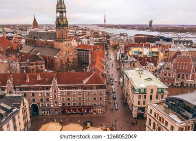 Aerial view of the roofs of the old town with the tower of the Dome Cathedral and the House of the Blackheads during  winter season in Riga. Latvia.
