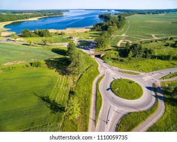 Aerial view of roundabout circles, railroad line and bike lanes, Mazury, Poland, Mamry Lake in the background