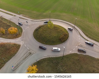 Aerial view of roundabout traffic with car