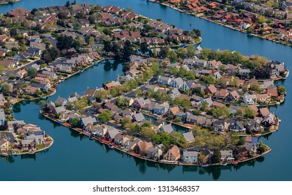 Aerial view of row houses in Foster City section on Central Lake canals by the San Francisco Bay in San Mateo County, California