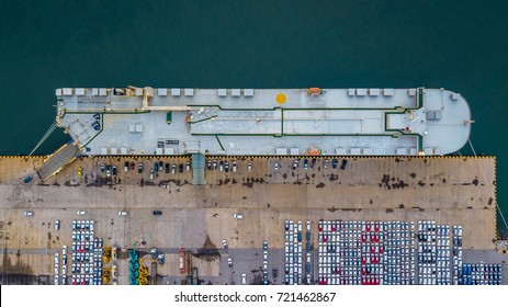 Aerial view rows of new cars waiting to be dispatch and shipped, New cars lined up in the port for import export around the world.