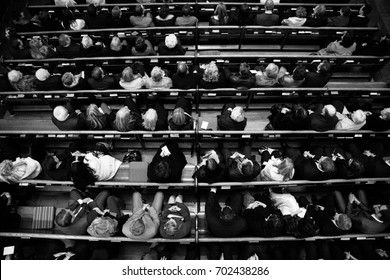 An aerial view of rows of seated people attending a church ceremony.