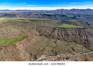 Aerial view of the rugged Arizona landscape after recent rains, topping Black Mesa near Black Canyon City with green grass