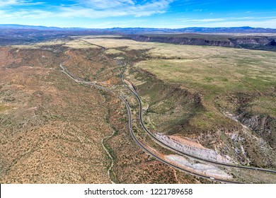 Aerial view of rugged landscape between Phoenix and Flagstaff with both directions of Interstate 17 viewed looking north near the Bumble exit