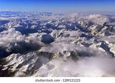 Aerial view of the rugged snow covered mountains of the Alps at the junction of Italy, France and Switzerland