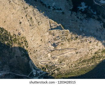 Aerial view of ruins of Albanian Castle located in mountains (Borsh Castle)