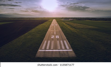Aerial view of a runway at sunset