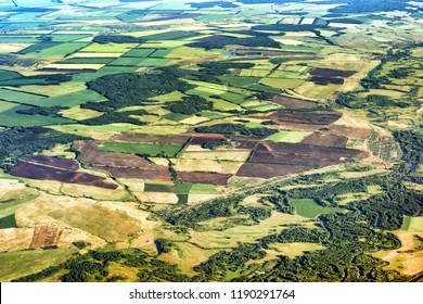 aerial view rural countryside landscape scenery in central europe ural russia with agricultural field crop forest village settlement road detail satellite exterior top down above overview background