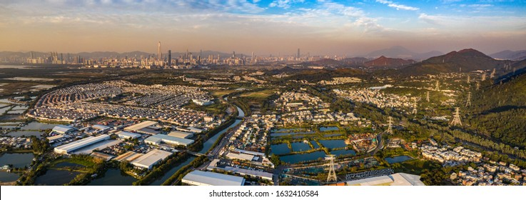 Aerial View of rural green fields in Hong Kong border and skylines in Shenzhen,China