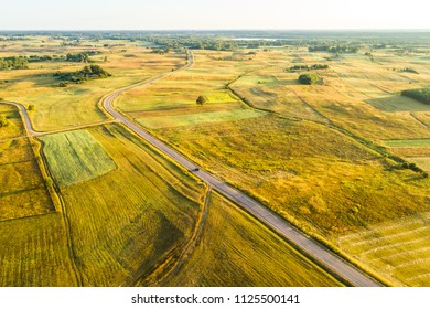 Aerial view of rural landscape with crop fields and road in Moletai region, Lithuania