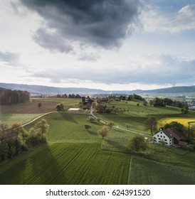 Aerial view of rural landscape with dramatic cloud