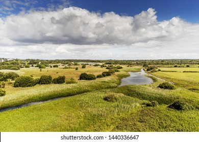 Aerial view rural landscape, green field, river, blue cloudy sky, sunny day, county Galway.
