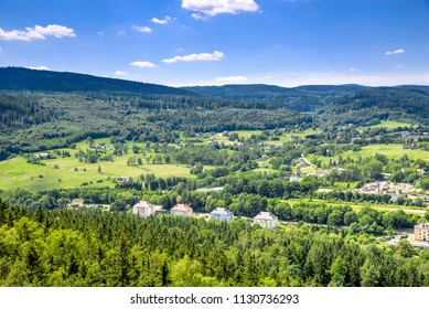 Aerial view of rural landscape in mountain valley, town and houses in nature