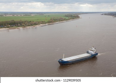 aerial view of a rusty blue coaster on the river Weser in front of the island Harriersand, Germany
