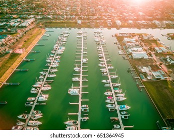 Aerial view of Safety Beach marina and suburb at sunset