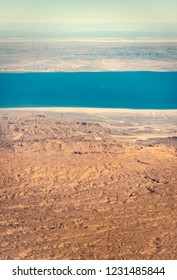 Aerial view of the Sahara desert and the Red Sea (Gulf of Suez) photographed from an airplane window. Egypt, Africa.