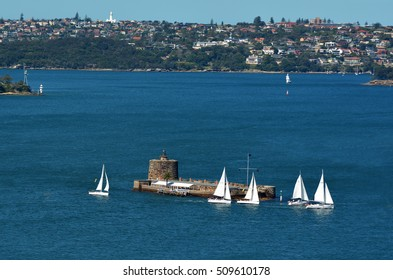 Aerial view of sail boats sails around  Fort Denison on Pinchgut Island in Sydney New South Wales, Australia