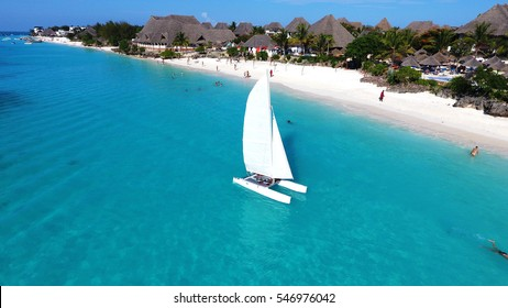Aerial view of sailboat at sea in  Zanzibar beach, Tanzania.