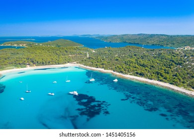 Aerial view of sailing boats in a beautiful azure turquoise lagoon on Sakarun beach on Dugi Otok island, Croatia, beautiful seascape