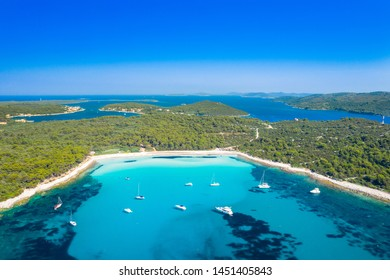 Aerial view of sailing boats in a beautiful azure turquoise lagoon on Sakarun beach bay on Dugi Otok island, Croatia, beautiful seascape