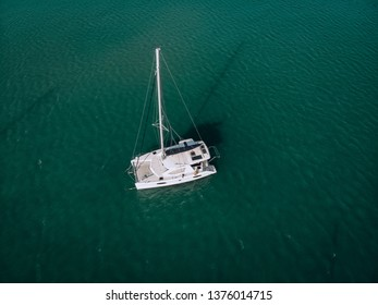 Aerial view of a  sailing yacht in the turquoise water of the Andaman sea. Phuket. Thailand