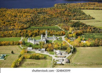 Aerial view of Saint Benoit du Lac Abbey in Quebec's Eastern Townships during foliage season