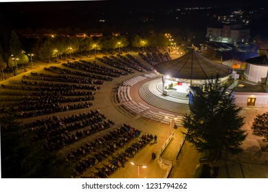 Aerial view of the Saint James Church at night, during mass (Crkva Svetog Jakova) in Medjugorje, Bosnia and Herzegovina
