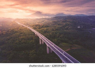 Aerial view of Salatiga tollway at sunset time in Central Java, Indonesia