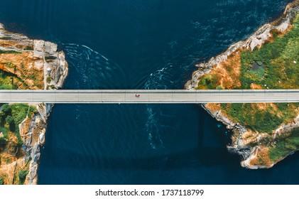 Aerial view Saltstraumen bridge in Norway road above sea connecting islands top down scenery transportation infrastructure famous landmarks scandinavian landscape