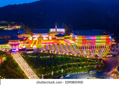 Aerial view of Samgwangsa temple at nighttime in Busan city, South Korea.Thousands of paper lanterns decorate Samgwangsa Temple in Busan city of South Korea for Buddha's Birthday.