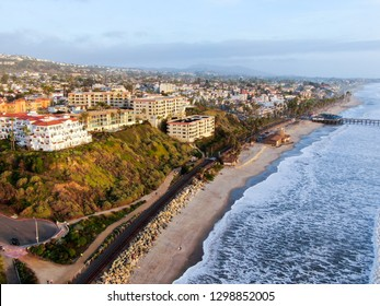 Aerial view of San Clemente Pier with beach and coastline before sunset time . San Clemente city in Orange County, California, USA. Travel destination in the South West Coast. Famous beach for surfer.