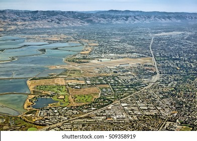 Aerial view of San Francisco bay area in California United States of America scenery with Moffett airfield city of San Jose 101 root bayshore freeway satellite landmark
