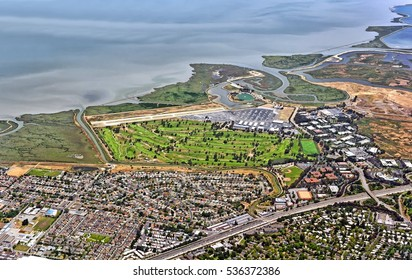 Aerial view of San Francisco bay area in California United States of America scenery with city of Palo Alto airport golf course Brentwood academies harbor 101 root bayshore freeway satellite landmark