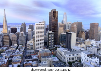 Aerial view of San Francisco Financial District as seen from a building rooftop in Nob Hill at dusk.