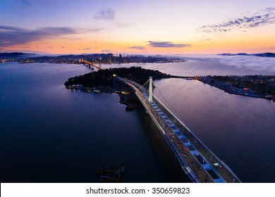 Aerial view of San Francisco Oakland Bay Bridge and Treasure Island at sunset, California, USA