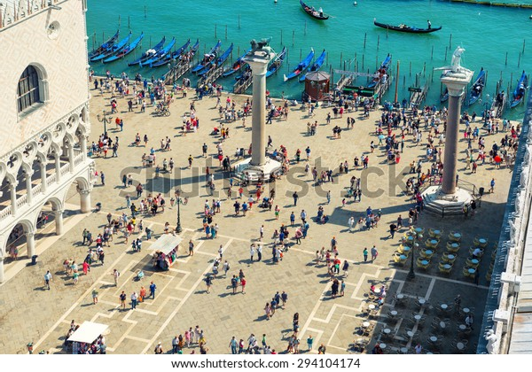Aerial view to San Marcus Square from bell tower. Crowd of people walking in Venice city.