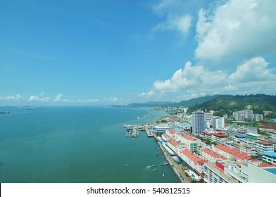 Aerial view of Sandakan city, its waterfront and surrounding area in the morning. It is the gateway to Sepilok Orangutan Sanctuary and the Labuk Bay Proboscis Monkey Sanctuary.