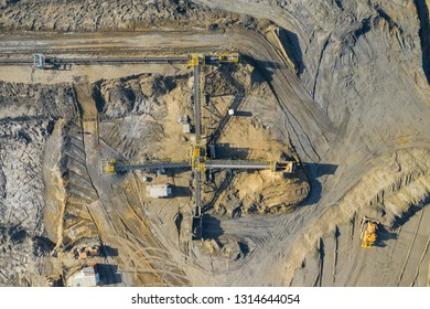 Aerial view of sandpit and factory plant producing sand materials for construction industry. Top view of industrial place. Photo captured with drone.