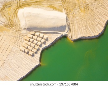 Aerial view of sandpit and factory plant producing sand materials for construction industry. Top view of large manufacturing plant in landscape. Halamky near Trebon, Czech republic, European union.