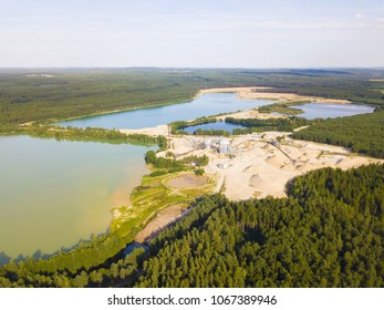 Aerial view of sandpit with lakes and factory plant producing sand materials for construction industry. Halamky near Trebon, Czech republic, European union.