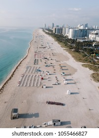 Aerial view of sandy beach with sun loungers, Miami Beach, Florida, USA
