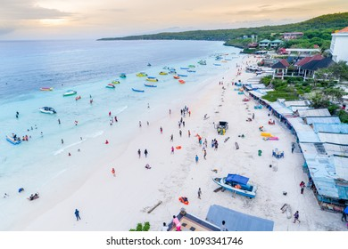 Aerial View of Sandy Beach with Tourists Swimming in Beautiful Clear Sea Water, Tanjung Bira Beach South Sulawesi Indonesia