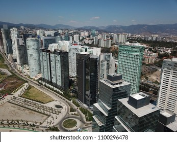 Aerial view of Santa Fe Mexico buildings and skyscrapers with mountain as background