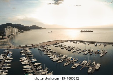 Aerial view of the Santa Marta bay with the yachts parking at sunset in Colombia
