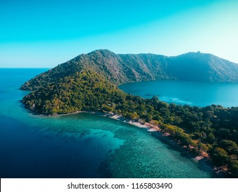 Aerial view of Satonda Island, Indonesia. The idyllic volcanic island of Satonda is fringed by coral reef in Indonesia. This tropical area is found in the geologically active ring of fire