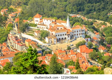 Aerial view of scenic National Palace of Sintra or Town Palace, in Portuguese Palacio Nacional de Sintra, with two white famous chimneys rising out of palace. Sintra, Portugal. Unesco Heritage Site