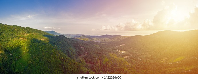 Aerial view of scenic sunset over jungle mountains at Ko Samui island, Thailand