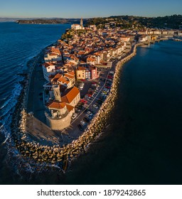 Aerial view of scenic town Piran with a lighthouse in foreground, Slovenia